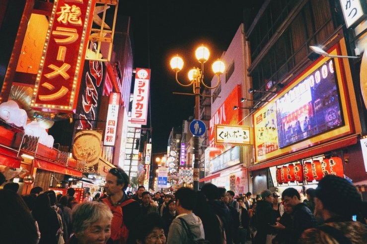 Dotonbori at night is pretty special. Super crowded, but very lively. And street food everywhere.